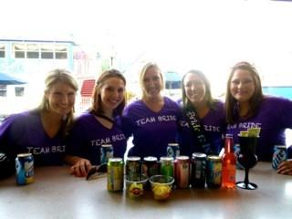 bachlorette party girls in neon purple V-neck T-shirts from Fluorescent Works