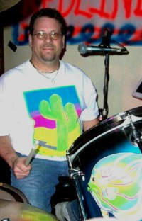 Lee Matejka, of Redline, in a Fluorescent, imprinted T-shirt, 2nd photo