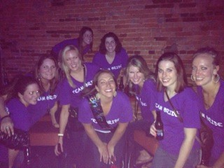 bachlorette party girls in neon purple V-neck T-shirts from Fluorescent Works, 2nd photo