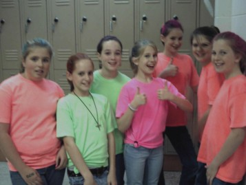 2nd photo of performing arts students wearing neon T-shirts, just before show time.