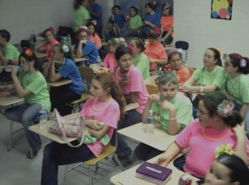 Performing arts students from Bath Elementary School wearing neon T-shirts, just before show time.