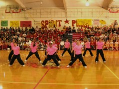 High School Breaker Girls dance group in neon pink T-shirts, in the gym, 2nd photo