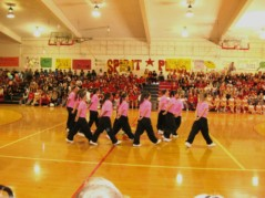 High School Breaker Girls dance group in neon pink T-shirts, in the gym, 3rd photo