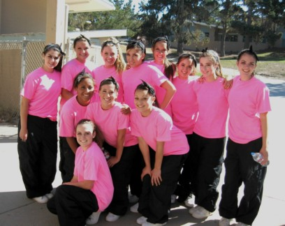 Pacific Grove High School Breaker Girls dance group in neon pink T-shirts