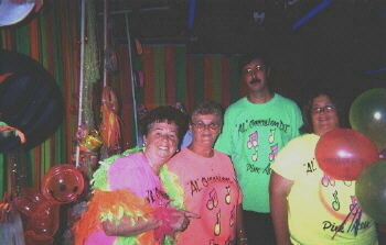 D.J. groupies at a black light party wearing imprinted, fluorescent / neon T-shirts