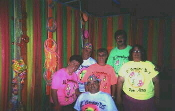 D.J. groupies at a black light party wearing imprinted, neon T-shirts, 2nd photo