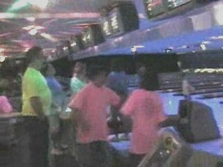 cosmic bowling in fluorescent / neon T-shirts