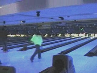 black light bowling in fluorescent / neon T-shirts, 2nd photo
