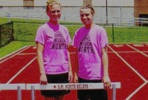 High School track and field hurdlers wearing neon pink T-shirts during practice, 4th photo