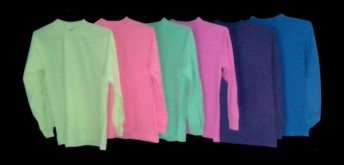 plain, long-sleeve, fluorescent / neon T-shirts in assorted colors, under black lights